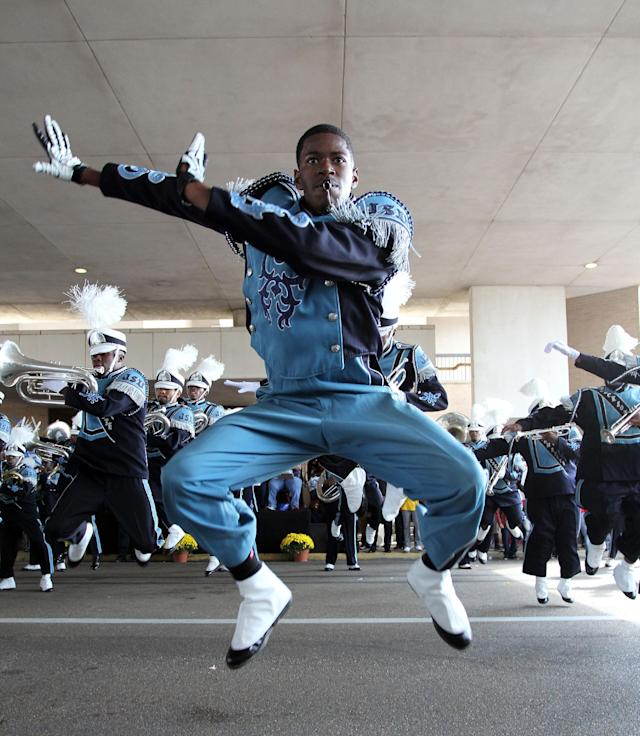 """Jackson State University """"Sonic Boom of the South"""" drum major dances during the annual homecoming day parade, Saturday, Oct. 19, 2013, in Jackson, Miss. Jackson State decided to continue with homecoming festivities after Saturday's NCAA college football game game against Grambling State was cancelled because disgruntled Grambling players refused to travel to Jackson. (AP Photo/Charles Smith)"""