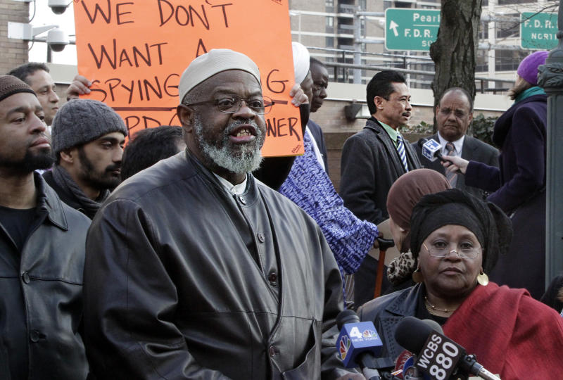 "Imam Hajj Talib Abdur Rashid, fourth from left, of the Mosque of the Islamic Brotherhood of New York, speaks for a group of Muslim leaders excluded from a meeting with New York City Police Commissioner Raymond Kelly, during a press conference following the meeting  on Friday, March 9, 2012 at police headquarters in New York.  Imam Abdur Rashid  accused Kelly of ""only meeting with isolated individuals"" who are his supporters and not his critics. Imam Shamsi Ali, third from right top, who was among Muslim leaders attending the meeting on the police surveillance of Muslim communities across the Northeast, spoke separately to reporters nearby.  (AP Photo/Bebeto Matthews)"