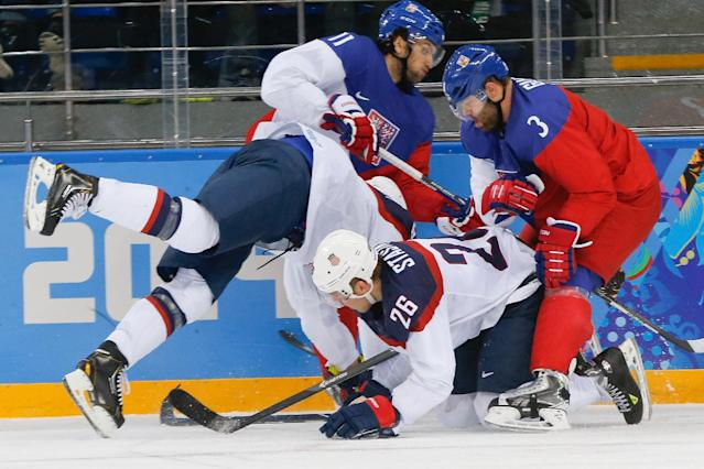 USA forward Max Pacioretty, USA forward Paul Stastny (26), Czech Republic forward Martin Hanzal (11) and Czech Republic defenseman Radko Gudas (3) battle for a loose puck during the second period of men's quarterfinal hockey game in Shayba Arena at the 2014 Winter Olympics, Wednesday, Feb. 19, 2014, in Sochi, Russia. (AP Photo/Petr David Josek)