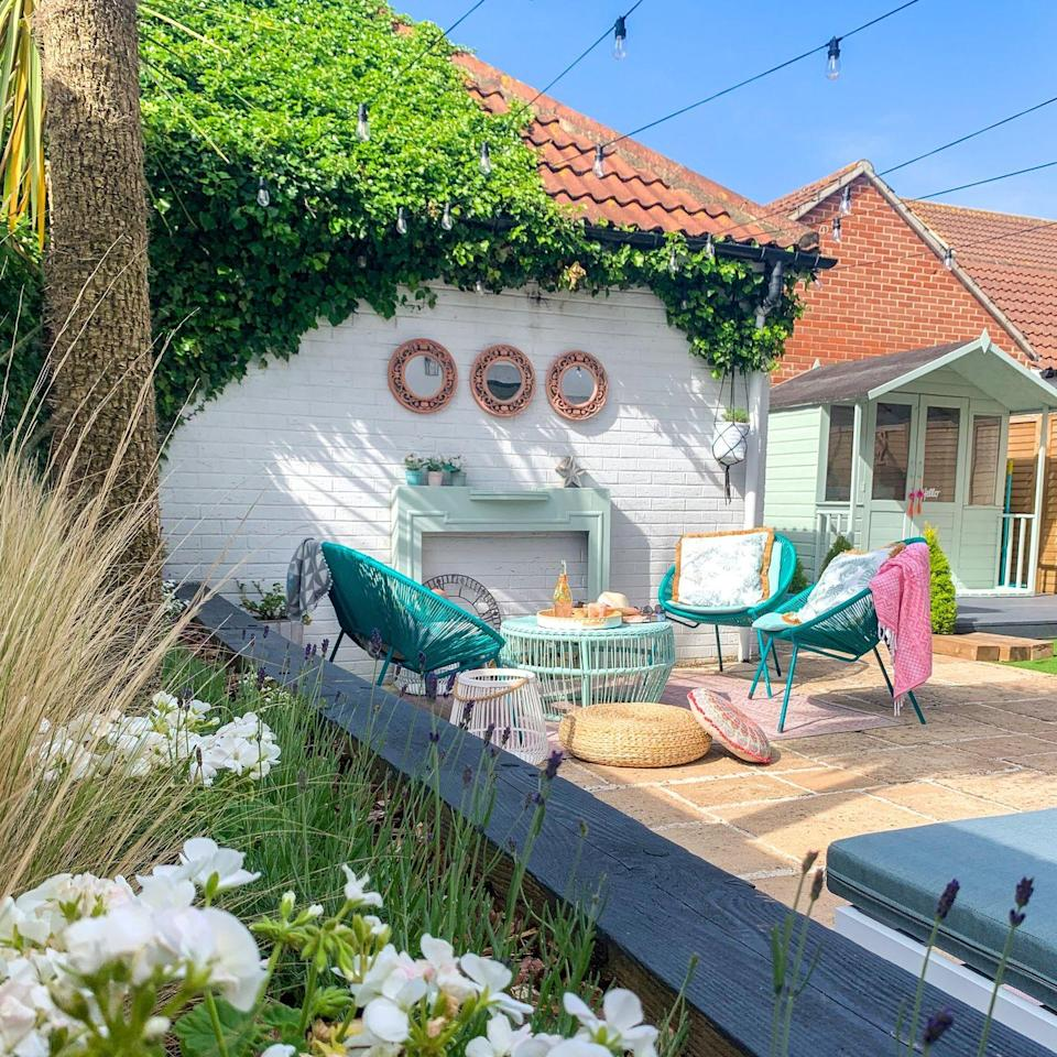 """<p>Wow, what a transformation! After lots of TLC and a much-needed pop of colour, this <a href=""""https://www.housebeautiful.com/uk/garden/seasons/a1363/gardening-march-jobs/"""" rel=""""nofollow noopener"""" target=""""_blank"""" data-ylk=""""slk:garden"""" class=""""link rapid-noclick-resp"""">garden</a> overhaul ticks all the right boxes. </p><p>Kel explains: 'The eyesore sub-station in the garden has been transformed into a feature (we didn't really have a choice!) by painting the brick white and adding a fire surround, plus <a href=""""https://www.housebeautiful.com/uk/garden/g28157692/garden-mirrors/"""" rel=""""nofollow noopener"""" target=""""_blank"""" data-ylk=""""slk:mirrors"""" class=""""link rapid-noclick-resp"""">mirrors</a> which have been painted in Annie Sloan and Cuprinol paint'. </p>"""
