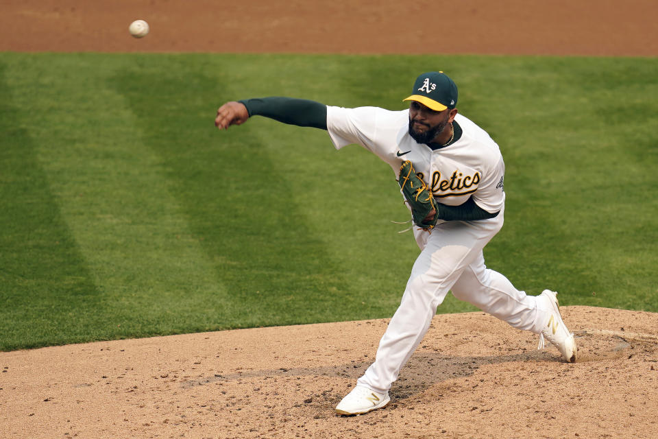 Oakland Athletics' Yusmeiro Petit pitches against the Chicago White Sox during the third inning of Game 3 of an American League wild-card baseball series Thursday, Oct. 1, 2020, in Oakland, Calif. (AP Photo/Eric Risberg)