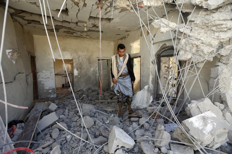 A Yemeni man inspects the damage in the aftermath of a reported air strike by the Saudi-led coalition in the Yemeni capital Sanaa on March 8, 2018. (MOHAMMED HUWAIS via Getty Images)