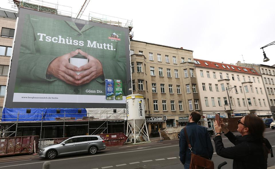 BERLIN, GERMANY - SEPTEMBER 12: An advertisement for a milk company shows German Chancellor Angela Merkel's trademark hand pose holding a glass of milk with the words