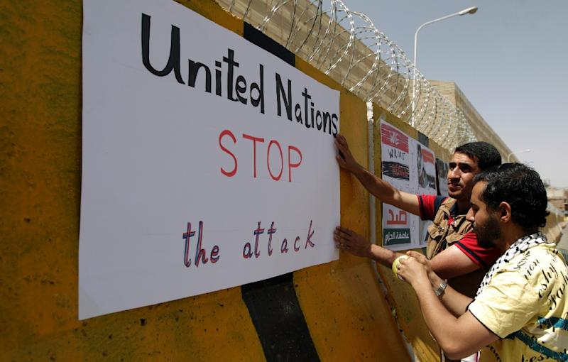Yemeni demonstrators place signs on concrete barriers at the Saudi embassy in Sanaa on April 11, 2015, during a gathering denouncing the Saudi-led coalition's Operation Decisive Storm against the Huthi rebels (AFP Photo/Mohammed Huwais)