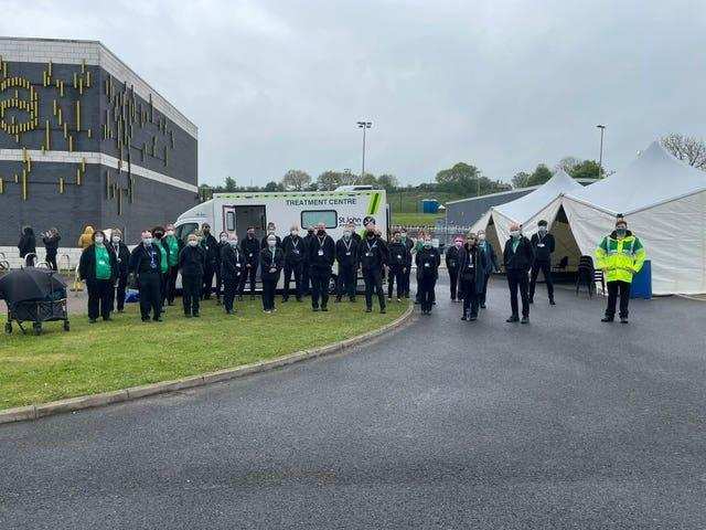 St John Ambulance vaccination volunteers at the ESSA Academy site in Bolton, Greater Manchester (St John Ambulance/AP)