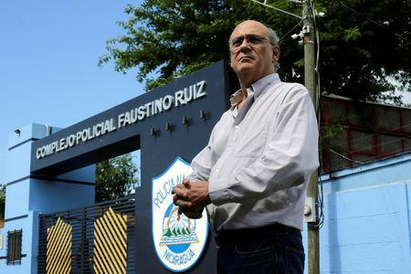 Journalist Carlos Fernando Chamorro, critic of the government of President Daniel Ortega stands in front of the main entrance of police headquarters in Managua, Nicaragua December 15, 2018.REUTERS/Oswaldo Rivas