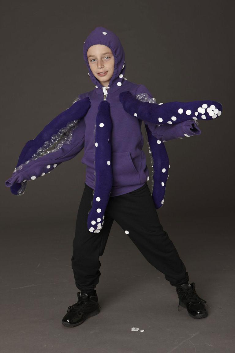 """<p>Dress your tween up in sweats and add tentacles to create a scary creature from the deep dark sea.</p><p><em><strong><a href=""""https://www.womansday.com/home/crafts-projects/how-to/a8645/diy-halloween-costume-octopus-123700/"""" rel=""""nofollow noopener"""" target=""""_blank"""" data-ylk=""""slk:Get the Purple Octopus tutorial"""" class=""""link rapid-noclick-resp"""">Get the Purple Octopus tutorial</a>.</strong></em></p>"""