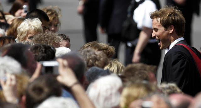 Prince William meets the crowds as he leaves the St Salvator's Quadrangle. William got a 2:1 in geography (David Cheskin/PA)
