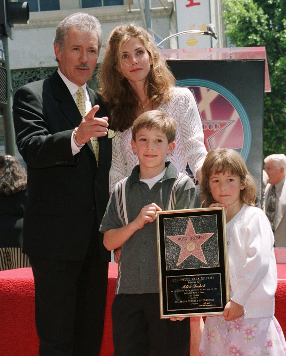 Game show host Alex Trebek, a native of Ontario, Canada poses with his family, wife Jean, son Matthew, 8 and daughter Emily,5, after his star on the Hollywood Walk of Fame was unveiled during ceremonies along Hollywood Boulevard May 17 in Hollywood. Trebek hosts the popular syndicated television game show
