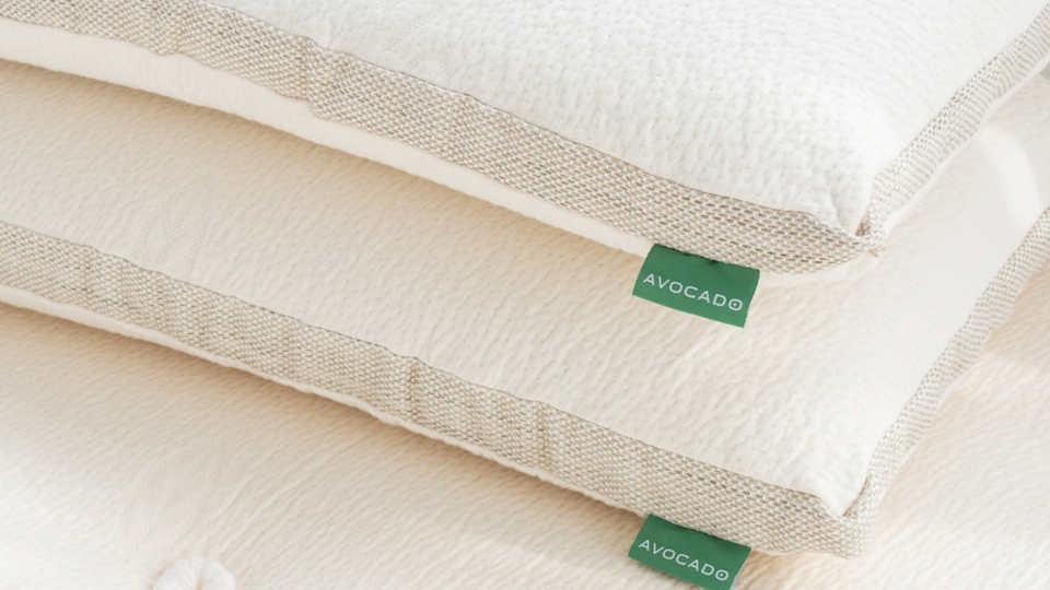 Avocado's molded latex and green pillows are 20% off.