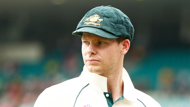 Australia's premier batsman Steve Smith looking at the pitch while fielding.