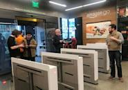 """Shoppers enter the Amazon Go store located in Amazon's """"Day 1"""" office building in Seattle, Washington, U.S., January 18, 2018. Photo taken January 18, 2018. REUTERS/Jeffrey Dastin"""