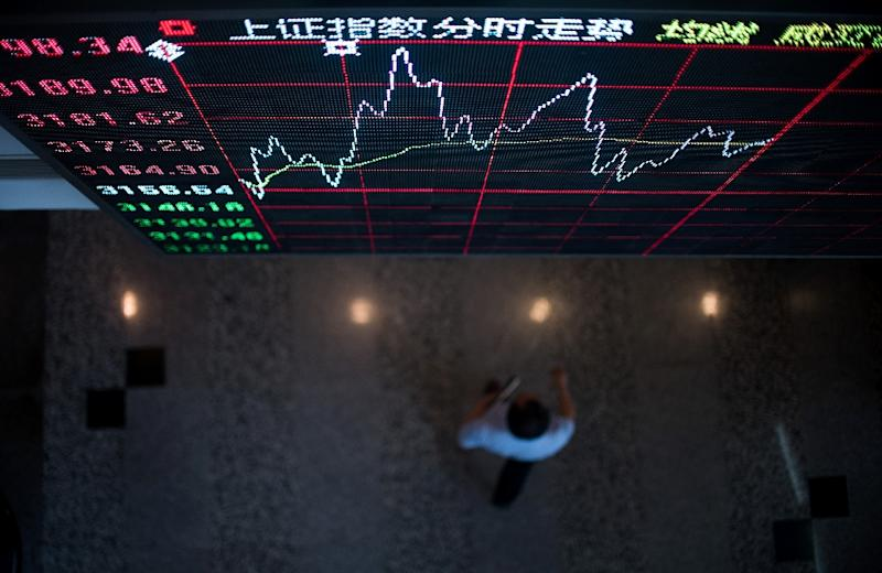 From January 1 to mid-June the Shanghai market -- which had already surged by more than 50 percent in 2014 -- leaped by 60 percent again and then slumped nearly a third in three weeks, before slowly recovering (AFP Photo/Johannes Eisele)