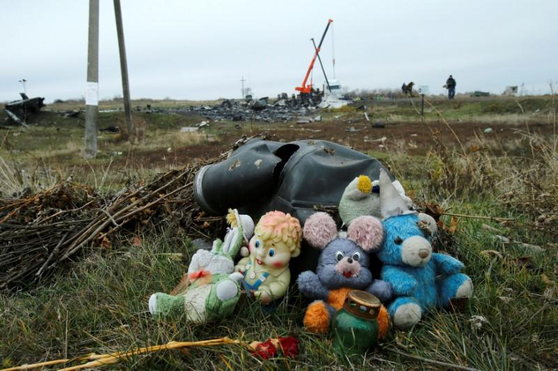 FILE PHOTO: Soft toys are seen near the crash site of the Malaysia Airlines Boeing 777 plane (flight MH17) near Grabovo in the Donetsk region