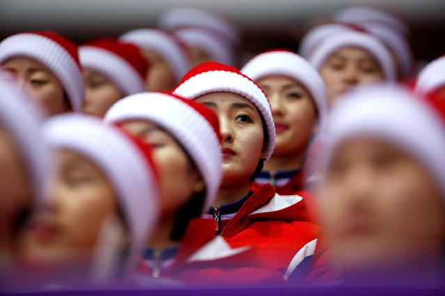 Short Track Speed Skating Events - Pyeongchang 2018 Winter Olympics - Women's 1000m Competition - Gangneung Ice Arena - Gangneung, South Korea - February 20, 2018. North Korean cheerleaders before the start. REUTERS/Phil Noble TPX IMAGES OF THE DAY