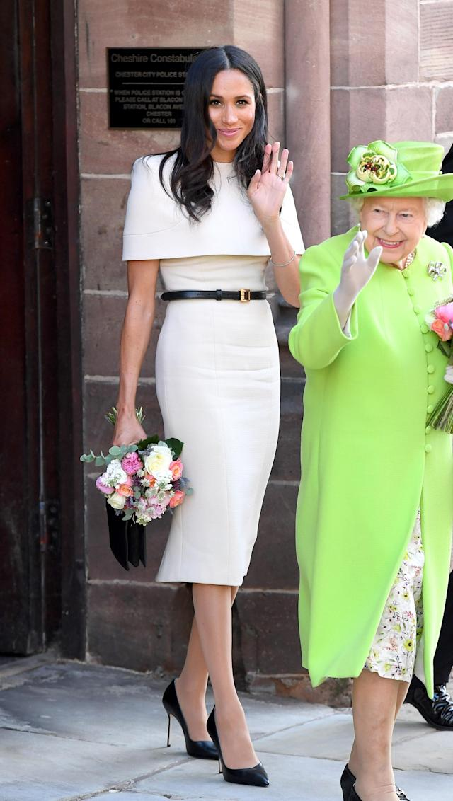 Melania's dress also bore a similarity to the belted Givenchy number Meghan wore in June. (Photo: Karwai Tang/WireImage)