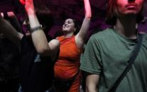 """A reveller dances during the """"00:01"""" event organised by Egyptian Elbows at Oval Space nightclub, as England lifted most coronavirus disease (COVID-19) restrictions at midnight, in London"""