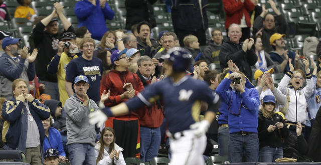Fans cheer as Milwaukee Brewers' Ryan Braun rounds the bases after his three-RBI home run against the Kansas City Royals in the third inning of an exhibition baseball game Friday, March 28, 2014, in Milwaukee. (AP Photo/Jeffrey Phelps)