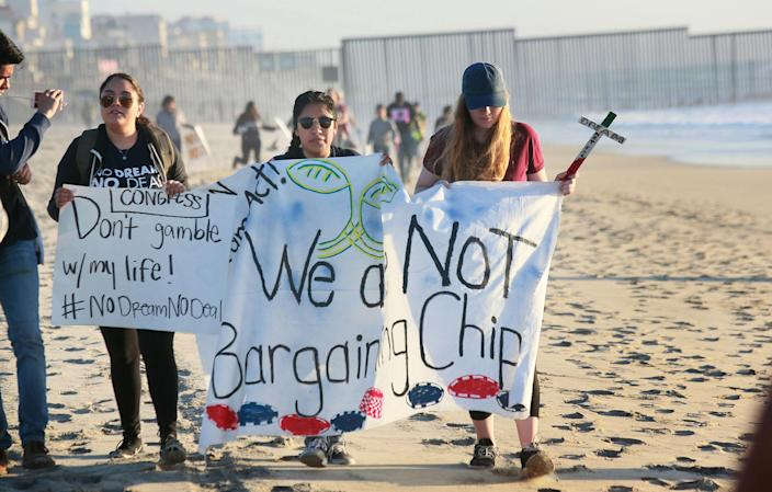 <p>Activists and immigrants stage a rally along the U.S.-Mexico border in support of passage of the Dream Act Feb. 7, 2018 in San Ysidro, Calif. (Photo: Sandy Huffaker/Getty Images) </p>