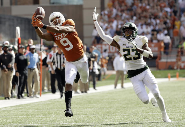 FILE - In this Oct. 13, 2018, file photo, Texas wide receiver Collin Johnson (9) makes a catch in front of Baylor cornerback Derrek Thomas (23) for 44-yard touchdown reception during the first half on an NCAA college football game, in Austin, Texas. A 10-4 finish with a big win in the Sugar Bowl energized Texas football to levels not seen in years. (AP Photo/Eric Gay)