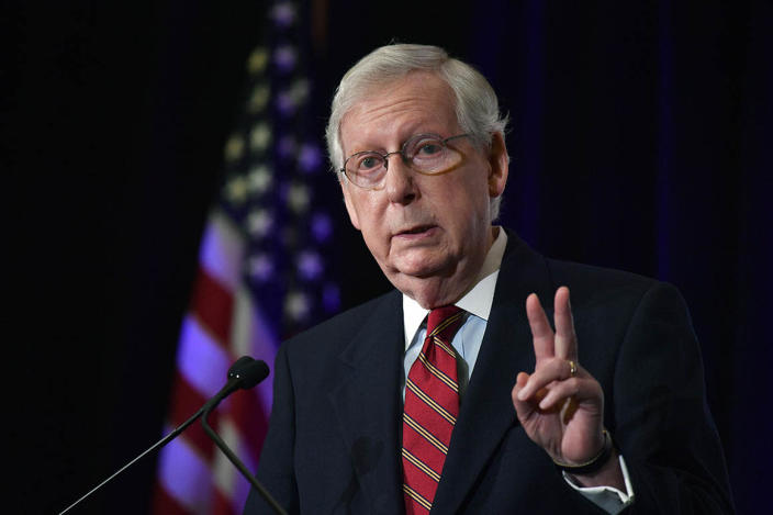 Senate Majority Leader Mitch McConnell speaks to reporters during a press conference.