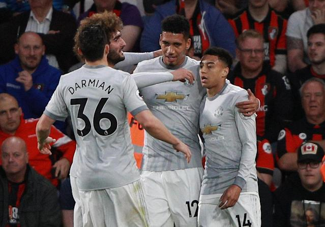"""Soccer Football - Premier League - AFC Bournemouth vs Manchester United - Vitality Stadium, Bournemouth, Britain - April 18, 2018 Manchester United's Chris Smalling celebrates scoring their first goal with Jesse Lingard, Marouane Fellaini and Matteo Darmian REUTERS/Ian Walton EDITORIAL USE ONLY. No use with unauthorized audio, video, data, fixture lists, club/league logos or """"live"""" services. Online in-match use limited to 75 images, no video emulation. No use in betting, games or single club/league/player publications. Please contact your account representative for further details."""