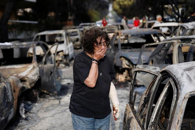 <p>A woman reacts as she tries to find her dog, following a wildfire at the village of Mati, near Athens, Greece, July 24, 2018. (Photo: Costas Baltas/Reuters) </p>