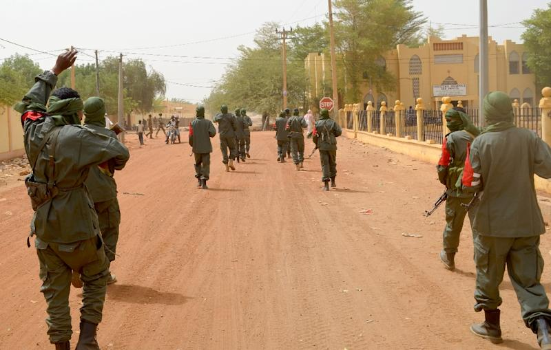 Malian soldiers patrol the northern city of Gao in February 2017