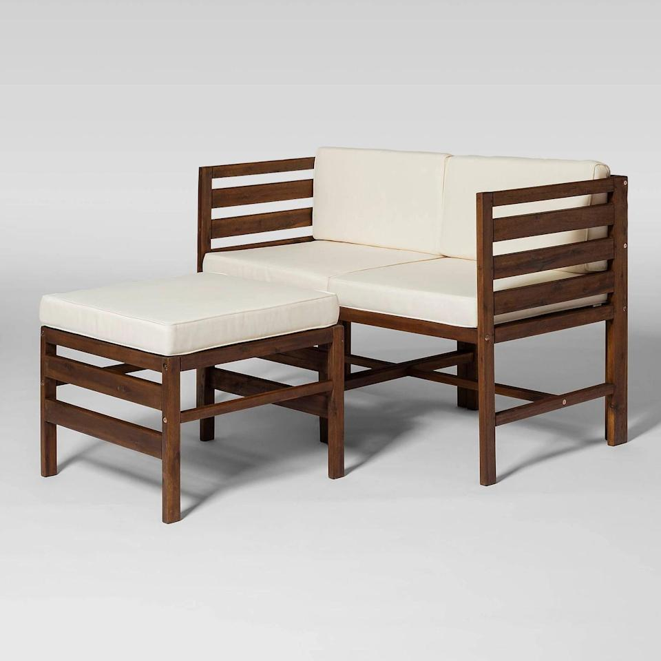 <p>The armchair and ottoman in the <span>Modular Outdoor Acacia Chairs and Ottoman</span> ($590) can be rearranged however you'd like - you can even put the ottoman in the middle for an extra large bench.</p>