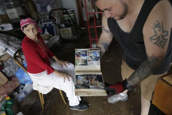Flood-damaged family photos in a New-Jersey home - AP Photo