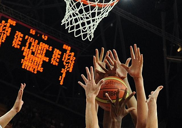 TOPSHOTS Players try to catch the ball during the Women's preliminary round group B basketball match of the London 2012 Olympic Games Australia vs Brazil on August 1, 2012 at the basketball arena in London. Australia won 67 to 61. AFP PHOTO / MARK RALSTONMARK RALSTON/AFP/GettyImages