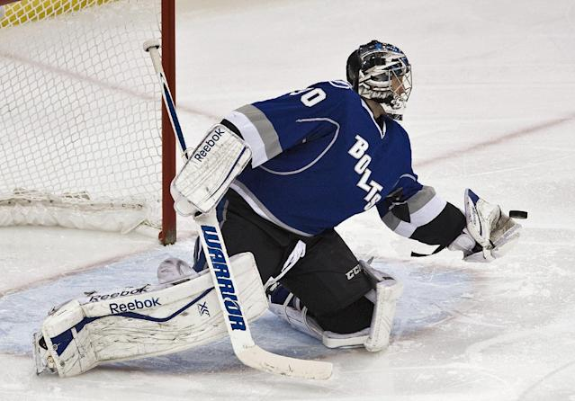 Tampa Bay Lightning goalie Ben Bishop makes a glove save during the first period of an NHL hockey game against the Montreal Canadiens on Saturday, Dec. 28, 2013, in Tampa, Fla. (AP Photo/Steve Nesius)