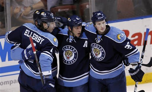 Florida Panthers' Stephen Weiss, center, is congratulated by teammates Keaton Ellerby (4) and Jerred Smithson (25) after scoring against the Montreal Canadiens in the first period of an NHL hockey game in Sunrise, Fla., Sunday, Feb., 26, 2012. (AP Photo/Alan Diaz)