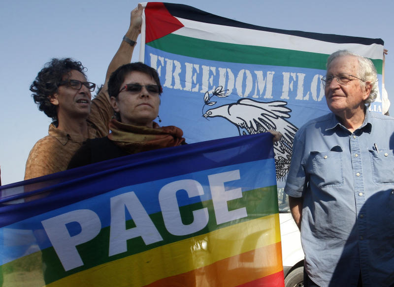 Jewish-American scholar and activist Noam Chomsky, right, stands during a press conference to support the Gaza-bound flotilla in the port of Gaza City, Saturday, Oct. 20 , 2012. Israeli soldiers commandeered a vessel carrying pro-Palestinian activists destined for Gaza on Saturday, cutting off communications and steering it from international waters toward the Israeli port of Ashdod. The ship was the latest in a series of activist-manned vessels challenging Israel's blockade on the territory, imposed when the militant group Hamas seized the coastal strip in 2007. (AP Photo/Hatem Moussa)