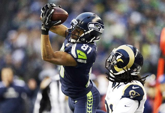 Seattle Seahawks wide receiver Golden Tate (81) makes a catch in front of St. Louis Rams cornerback Janoris Jenkins that Tate ran for a touchdown in the second half of an NFL football game, Sunday, Dec. 29, 2013, in Seattle. (AP Photo/Elaine Thompson)