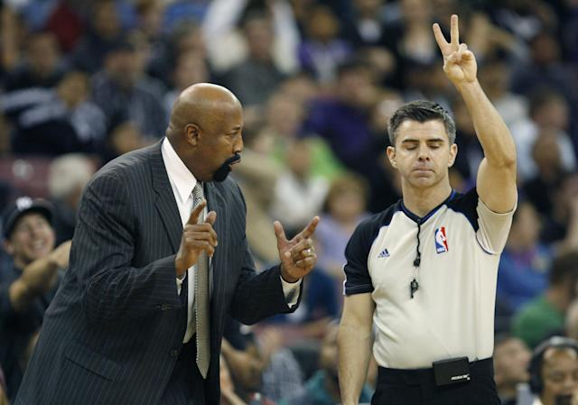 New York Knicks head coach Mike Woodson, left, questions official Eli Roe during the second half of an NBA basketball game against the Sacramento King in Sacramento, Calif., on Wednesday, March 26, 2014.The Knicks won 107-99.(AP Photo/Steve Yeater)