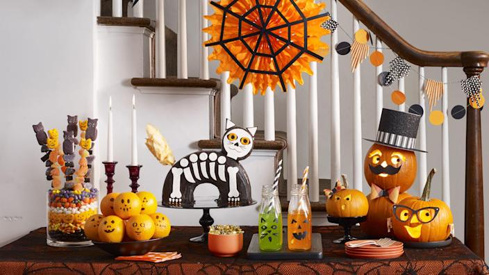"""<p>If you're a big fan of the spookiest day of the year, there's arguably no better way to celebrate than to throw an elaborate, all-out Halloween party. After all, what better way to show off your family's <a href=""""https://www.womansday.com/halloween-costumes/"""" rel=""""nofollow noopener"""" target=""""_blank"""" data-ylk=""""slk:Halloween costumes"""" class=""""link rapid-noclick-resp"""">Halloween costumes</a>, your DIY <a href=""""https://www.womansday.com/home/decorating/g1279/easy-halloween-decorations/"""" rel=""""nofollow noopener"""" target=""""_blank"""" data-ylk=""""slk:Halloween decorations"""" class=""""link rapid-noclick-resp"""">Halloween decorations</a>, and your Halloween snack skills than to invite friends, family, and loved ones over in the name of all things spooky and scary? So if you're wondering how to best throw a Halloween party, complete with a <a href=""""https://www.womansday.com/life/entertainment/g33289097/halloween-songs/"""" rel=""""nofollow noopener"""" target=""""_blank"""" data-ylk=""""slk:Halloween music"""" class=""""link rapid-noclick-resp"""">Halloween music</a> playlist and fun <a href=""""https://www.womansday.com/life/g28153252/halloween-games/"""" rel=""""nofollow noopener"""" target=""""_blank"""" data-ylk=""""slk:Halloween games"""" class=""""link rapid-noclick-resp"""">Halloween games</a>, there are more than a few fun and spooky Halloween party ideas that'll help you throw the bash of the year. <br></p><p>Hosting a big costume party in your backyard for friends and family? No problem. Spending the night at home and need some ideas to keep the kids entertained? Piece of cake. The following easy-to-pull-off Halloween party ideas include everything from fun <a href=""""https://www.womansday.com/food-recipes/food-drinks/g2468/easy-halloween-drinks/"""" rel=""""nofollow noopener"""" target=""""_blank"""" data-ylk=""""slk:Halloween-themed drinks"""" class=""""link rapid-noclick-resp"""">Halloween-themed drinks</a>, food, and desserts, to family-friendly <a href=""""https://www.womansday.com/home/crafts-projects/g2490/halloween-kids-crafts/"""" rel=""""nofollow noopener"""" target"""