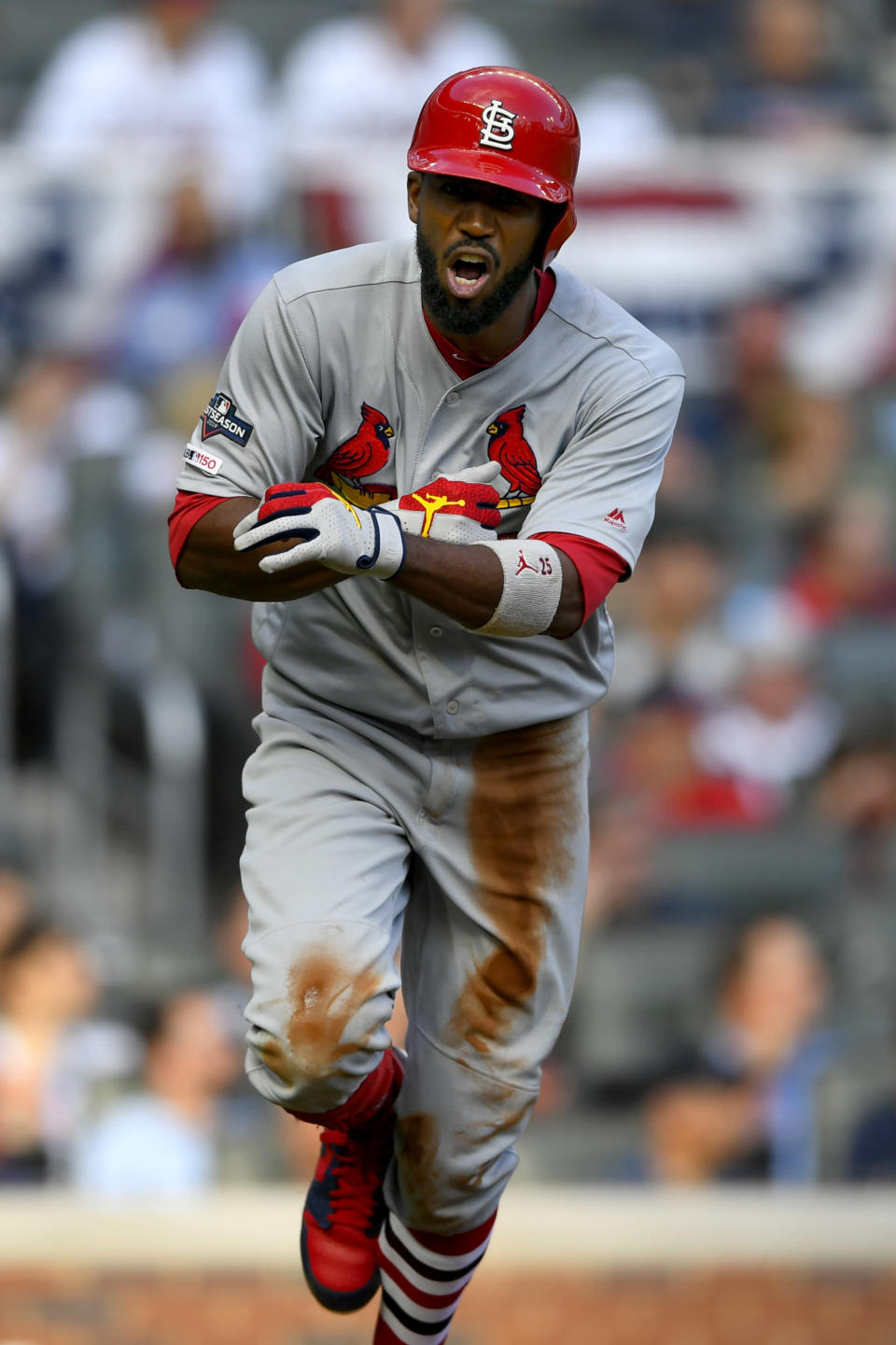 St. Louis Cardinals' Dexter Fowler hits a three-run double during the first inning of Game 5 of their National League Division Series baseball game against the Atlanta Braves, Wednesday, Oct. 9, 2019, in Atlanta. (AP Photo/John Amis)