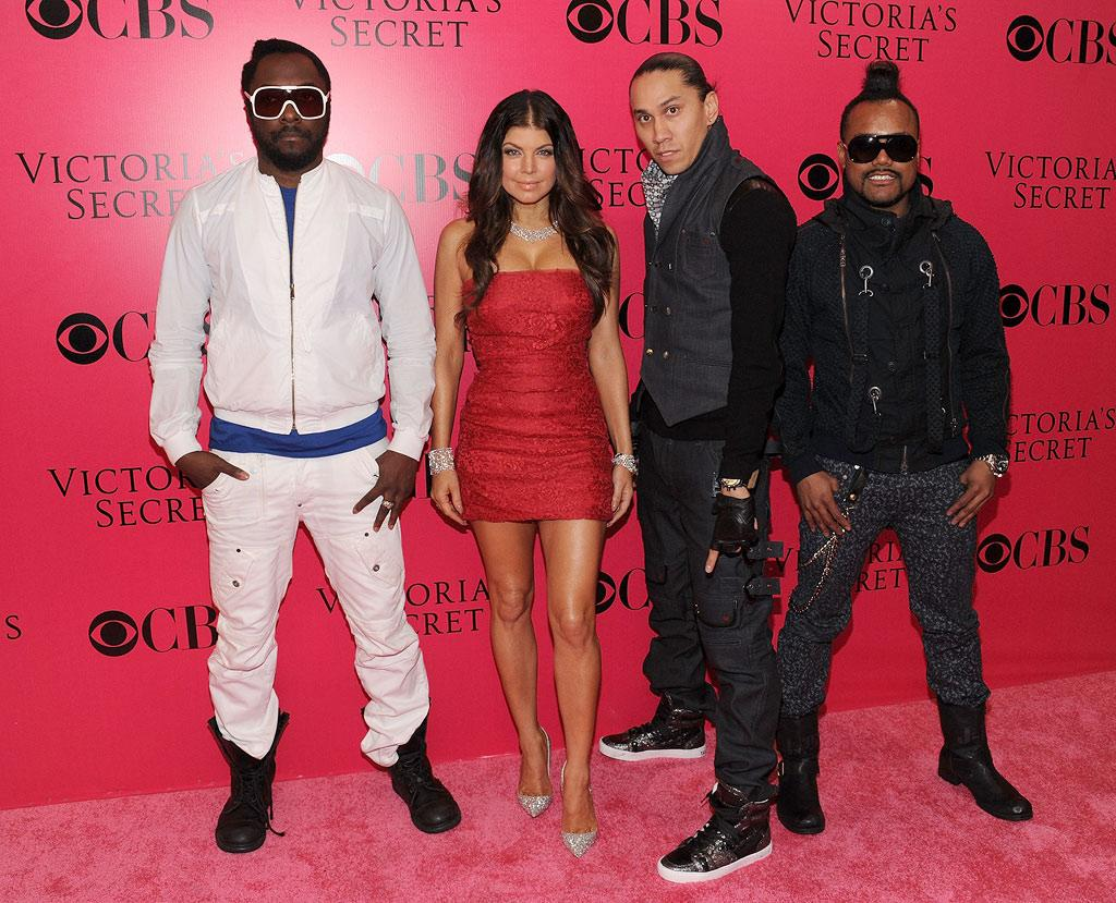 """The Black Eyed Peas performed for the packed house at the Lexington Avenue Armory. While a bejeweled Fergie rocked a strapless frock on the red carpet, her bandmates looked ready to rumble. Bryan Bedder/<a href=""""http://www.gettyimages.com/"""" target=""""new"""">GettyImages.com</a> - November 19, 2009"""