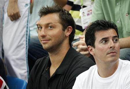 Former world champion Ian Thorpe of Australia watches the swimming events at the National Aquatics Centre during the 2008 Beijing Olympics