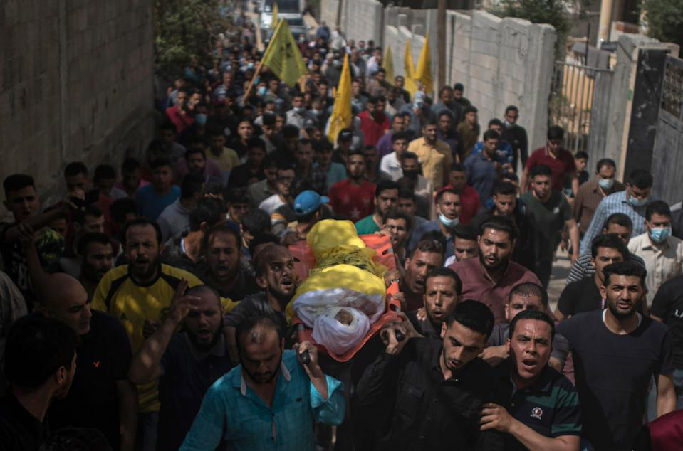 Palestinian mourners carry the body of 11-year-old Hussain Hamad (AP)
