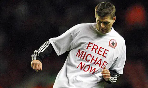 Steven Gerrard wearing a T-shirt in support of Michael Shields