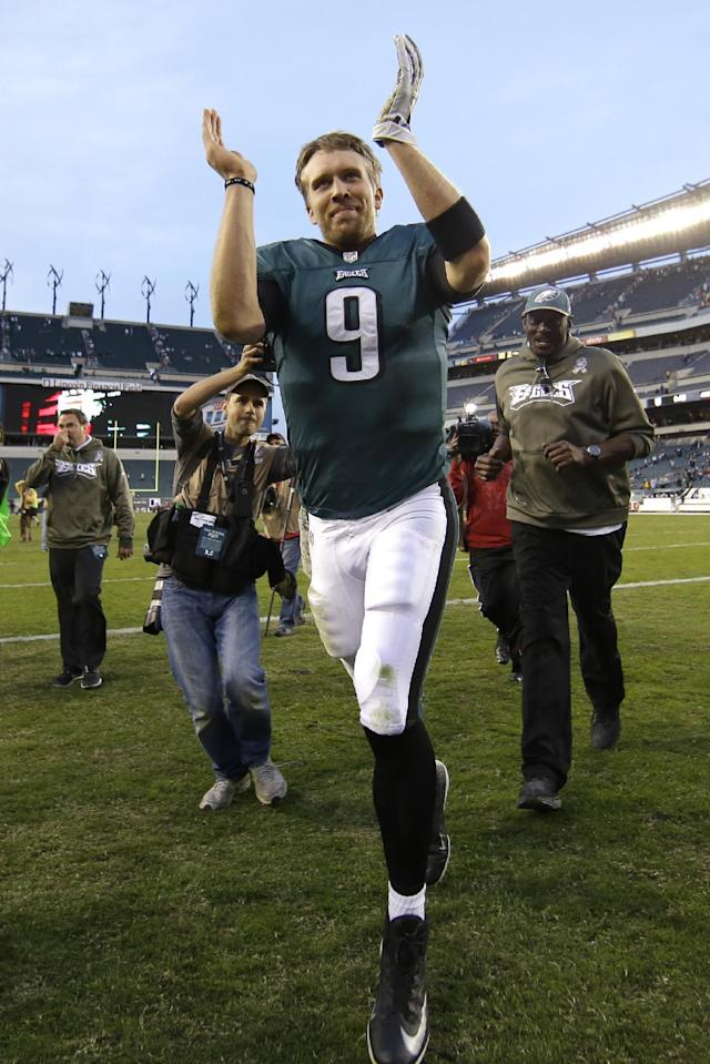 Philadelphia Eagles quarterback Nick Foles runs off the field after an NFL football game against the Washington Redskins in Philadelphia, Sunday, Nov. 17, 2013. The Eagles defeated the Redskins 24-16. (AP Photo/Matt Slocum)