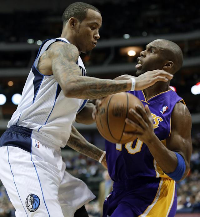 Dallas Mavericks' Monta Ellis, left, defends as Los Angeles Lakers' Jodie Meeks (20) looks for an opening to the basket in the first half of an NBA basketball game, Tuesday, Jan. 7, 2014, in Dallas. (AP Photo/Tony Gutierrez)