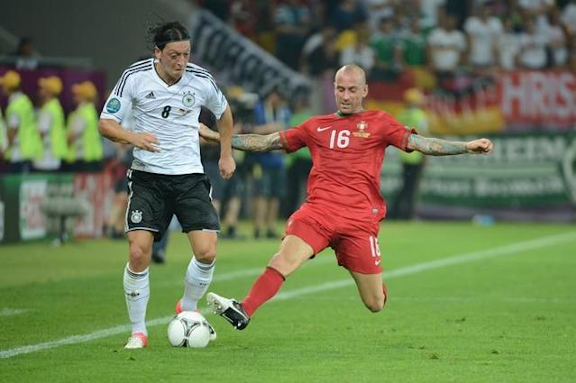Portuguese midfielder Raul Meireles (R) vies with German midfielder Mesut Oezil during the Euro 2012 championships football match Germany vs Portugal on June 9, 2012 at the Arena Lviv. AFP PHOTO / DAMIEN MEYERDAMIEN MEYER/AFP/GettyImages