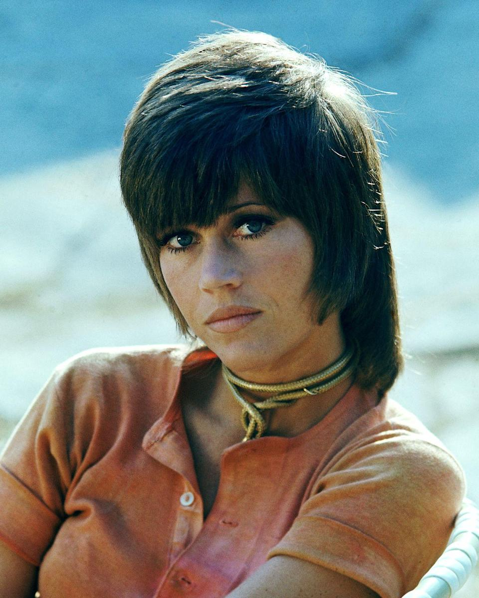 """<p>After hairstylist Paul McGregor cut Jane Fonda's hair into this funky short-and-long style for the 1971 film <em><a href=""""https://www.amazon.com/Klute-Andy-Lewis/dp/B00005U2KC?tag=syn-yahoo-20&ascsubtag=%5Bartid%7C2141.g.33928799%5Bsrc%7Cyahoo-us"""" rel=""""nofollow noopener"""" target=""""_blank"""" data-ylk=""""slk:Klute"""" class=""""link rapid-noclick-resp"""">Klute</a></em>, women began asking their own hairdressers for this unisex look.</p>"""