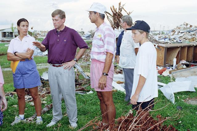 <p>Vice President Dan Quayle and wife Marilyn, left, talk with disaster relief worker Dan Forbes, center, at a site in Florida City, Fla., Sept. 12, 1992 where Hurricane Andrew ripped through a trailer park destroying everything in its path. Quayle toured areas South Florida as well as meeting with victims and military at tent city in Homestead for a roundtable discussion. (AP Photo/Kathy Willens) </p>