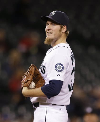 Seattle Mariners starting pitcher Brandon Maurer smiles as he sees that he's about to be relieved against the Los Angeles Angels in the seventh inning of a baseball game Thursday, April 25, 2013, in Seattle. (AP Photo/Elaine Thompson)