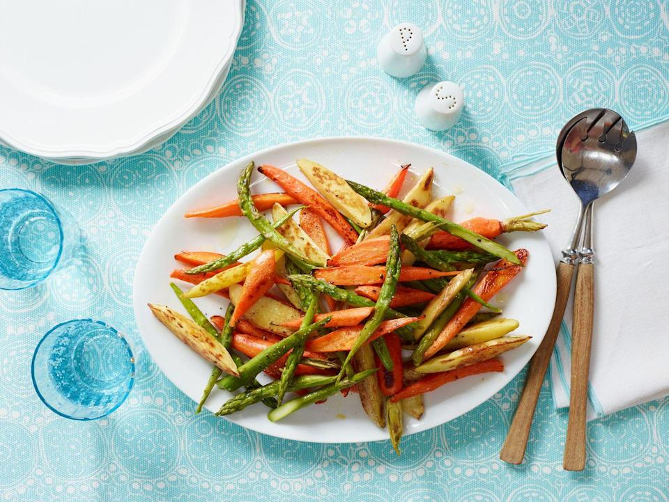 """<p>Add some major color (and flavor!) to your Passover table.</p><p><em><a href=""""https://www.womansday.com/food-recipes/food-drinks/recipes/a12106/orange-roasted-potatoes-carrots-asparagus-recipe-wdy0513/"""" rel=""""nofollow noopener"""" target=""""_blank"""" data-ylk=""""slk:Get the recipe from Woman's Day »"""" class=""""link rapid-noclick-resp"""">Get the recipe from Woman's Day »</a></em></p>"""