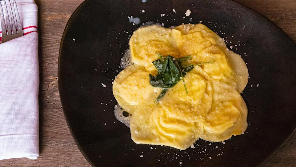 """<p>This rich ricotta ravioli in a butter and sage sauce rivals the kind of dishes you'll find at <a href=""""https://www.thedailymeal.com/eat/americas-best-italian-restaurants-gallery?referrer=yahoo&category=beauty_food&include_utm=1&utm_medium=referral&utm_source=yahoo&utm_campaign=feed"""" rel=""""nofollow noopener"""" target=""""_blank"""" data-ylk=""""slk:America's best Italian restaurants"""" class=""""link rapid-noclick-resp"""">America's best Italian restaurants</a>. Pair with some wine for a romantic dinner at home.</p> <p><a href=""""https://www.thedailymeal.com/best-recipes/ricotta-ravioli-via-vai?referrer=yahoo&category=beauty_food&include_utm=1&utm_medium=referral&utm_source=yahoo&utm_campaign=feed"""" rel=""""nofollow noopener"""" target=""""_blank"""" data-ylk=""""slk:For the Ricotta Ravioli in a Butter and Sage Sauce recipe, click here."""" class=""""link rapid-noclick-resp"""">For the Ricotta Ravioli in a Butter and Sage Sauce recipe, click here.</a></p>"""
